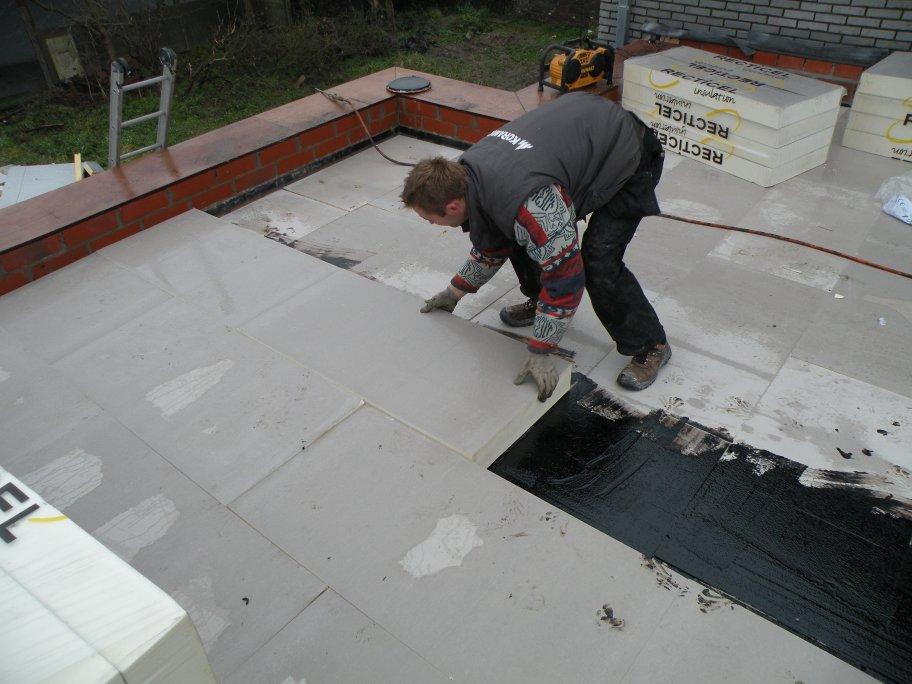 Plat dak isoleren door duin dakwerken